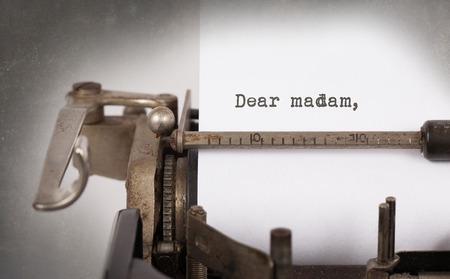 Vintage inscription made by old typewriter, Dear madam