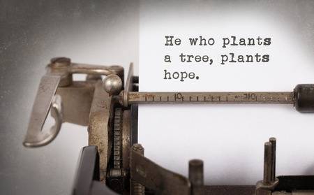 he old: Close-up of a vintage typewriter, old and rusty, he who plants a tree plants a hope Stock Photo