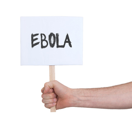 ebola: Hand holding sign, isolated on white - Ebola Stock Photo