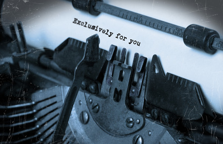 exclusively: Close-up of an old typewriter with paper, perspective, selective focus, Exclusively for you Stock Photo