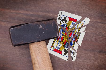 jack of clubs: Hammer with a broken card, vintage look, jack of clubs Stock Photo