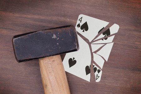 spades: Hammer with a broken card, vintage look, four of spades