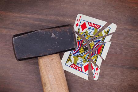 jack of diamonds: Hammer with a broken card, vintage look, jack of diamonds Stock Photo