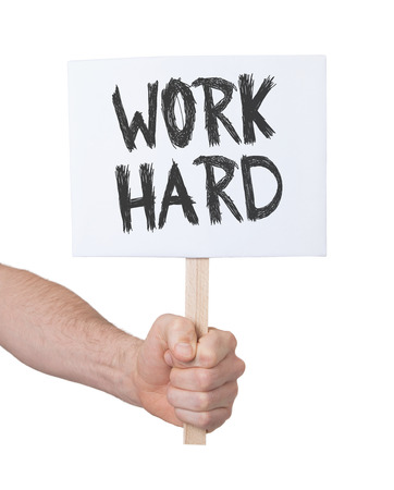 persepective: Hand holding sign, isolated on white - Work hard