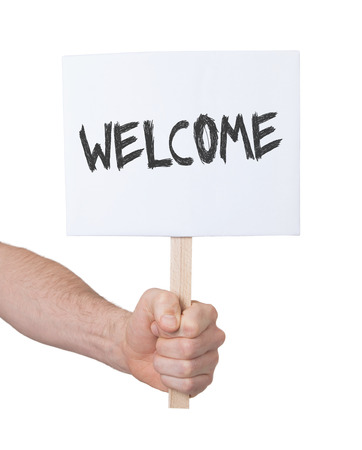persepective: Hand holding sign, isolated on white - Welcome