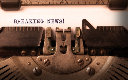 newsworthy: Vintage inscription made by old typewriter, breaking news