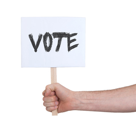 nomination: Hand holding sign, isolated on white - Vote Stock Photo