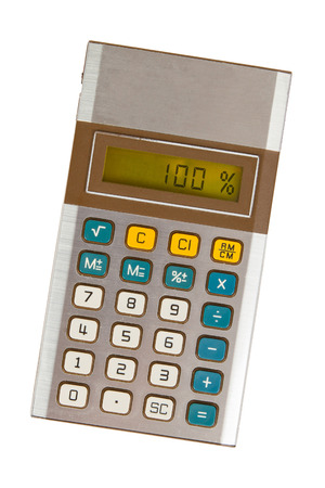 off balance: Old calculator with digital display showing a percentage - 100 percent