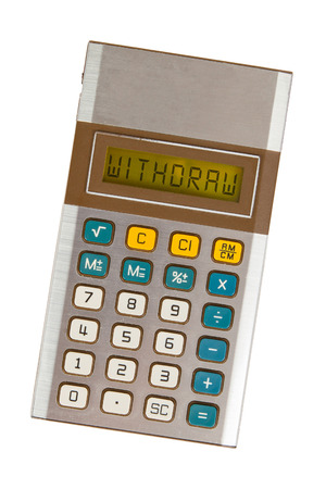 withdraw: Old calculator showing a text on display - withdraw Stock Photo