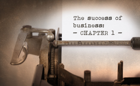 succes: Vintage typewriter, old rusty, warm yellow filter - The succes of business, chapter 1