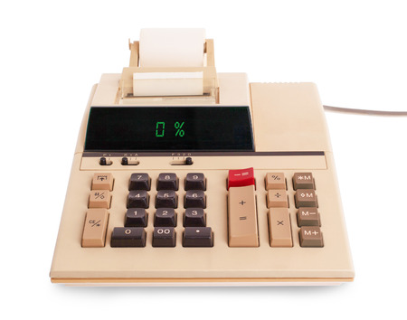 off balance: Old calculator with digital display showing a percentage - 0 percent Stock Photo