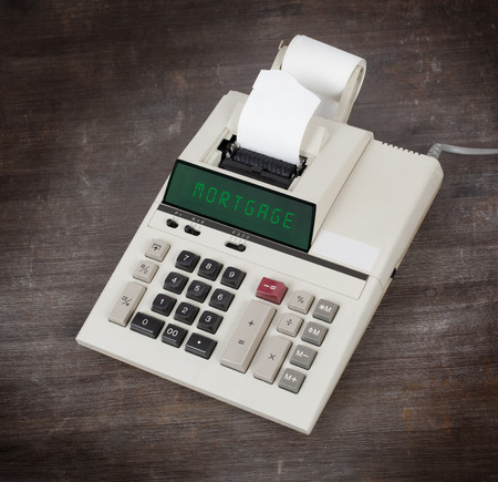 deflation: Old calculator showing a text on display - mortgage