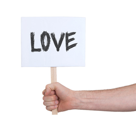 persepective: Hand holding sign, isolated on white - Love