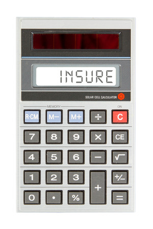 household accident: Old calculator showing a text on display - insurance