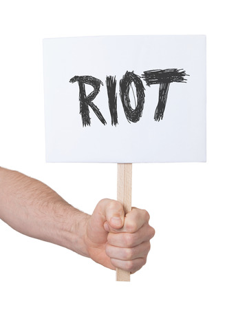 riot: Hand holding sign, isolated on white - Riot Stock Photo