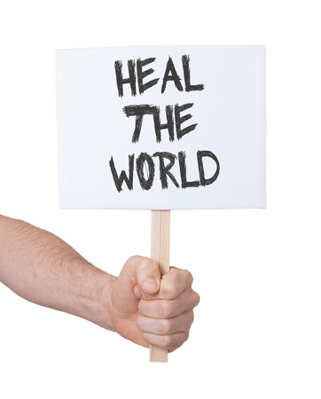 persepective: Hand holding sign, isolated on white - Heal the world