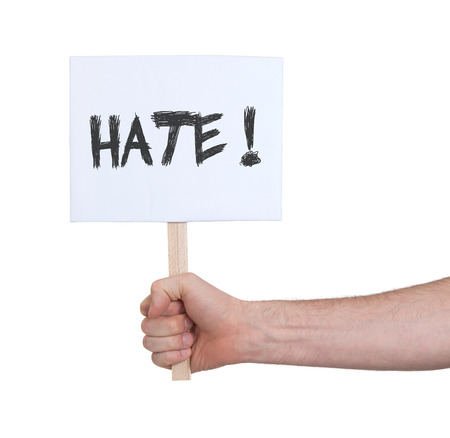 persepective: Hand holding sign, isolated on white - Hate Stock Photo