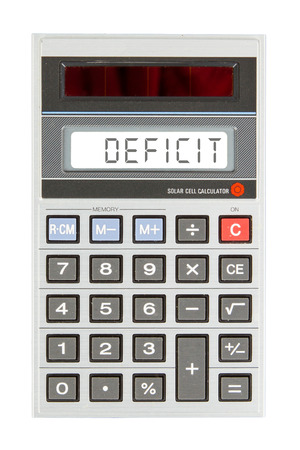Old calculator showing a text on display - deficit Stock Photo