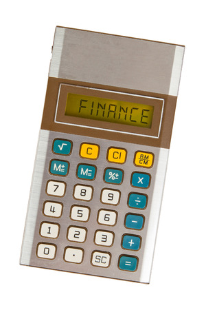 Old calculator showing a text on display - finance photo