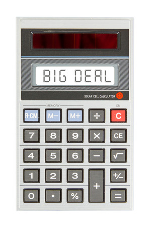 big deal: Old calculator showing a text on display - big deal