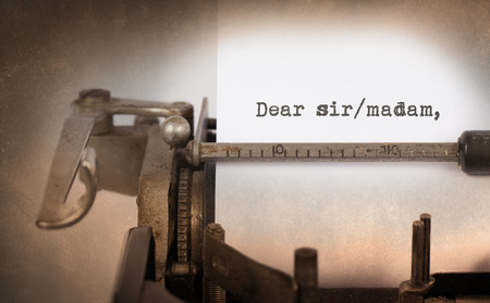 dear: Close-up of a vintage typewriter, old and rusty with dear sirmadam text Stock Photo