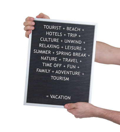 deserved: Vacation concept in plastic letters on very old menu board, vintage look Stock Photo