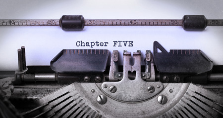 chapter: Vintage inscription made by old typewriter, chapter five Stock Photo