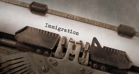 immigrate: Vintage typewriter, old rusty and used, immigration Stock Photo