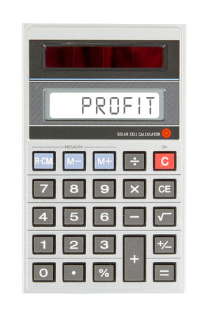Old calculator showing a text on display - profit photo