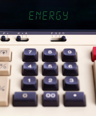 household money: Old calculator showing a text on display - energy