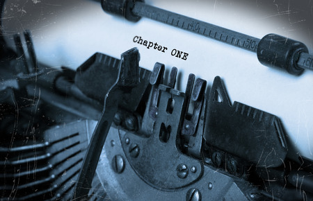 chapter: Close-up of an old typewriter with paper, perspective, selective focus, chapter one Stock Photo