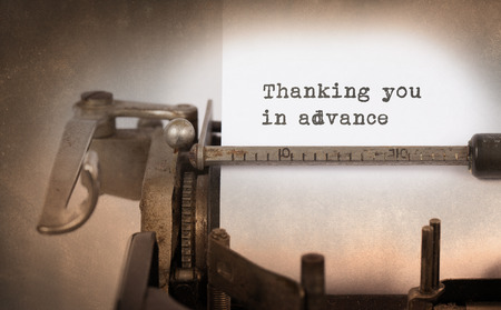 advance: Vintage inscription made by old typewriter, Thanking you in advance
