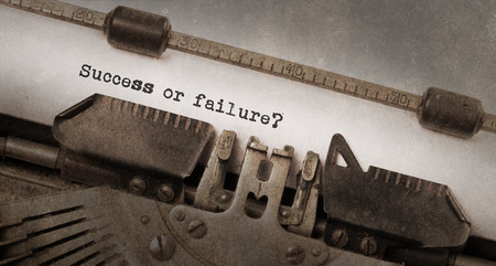 successfull: Vintage typewriter, old rusty and used, Success or failure Stock Photo