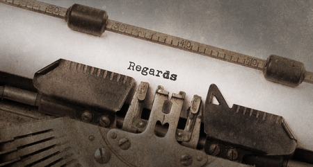 regards: Vintage typewriter, old rusty and used, Regards