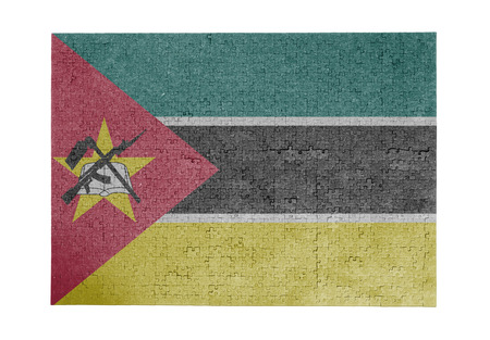 Large jigsaw puzzle of 1000 pieces - Mozambique flag Stock Photo