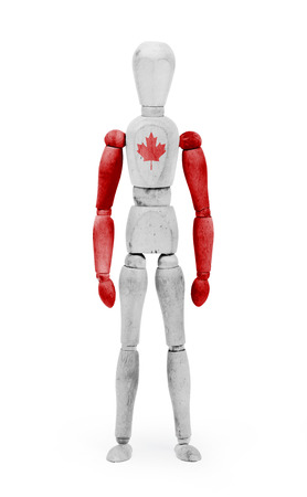 bodypaint: Wood figure mannequin with Canada flag bodypaint on white background  Stock Photo