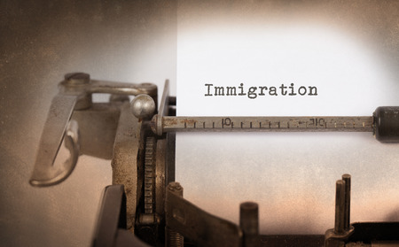immigrate: Close-up of a vintage typewriter, old and rusty, immigration Stock Photo