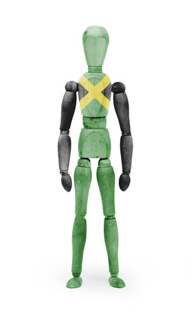 body paint: Wood figure mannequin with Jamaica flag body paint on white background