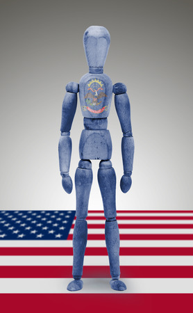 body paint: Old wood figure mannequin with US North Dakota state flag body paint