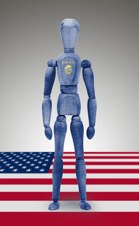 body paint: Old wood figure mannequin with US Montana state flag body paint Stock Photo