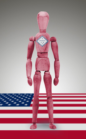 body paint: Old wood figure mannequin with US Arkansas state flag body paint