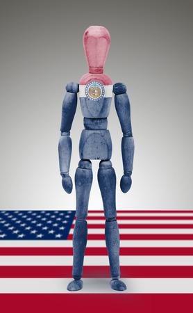 body paint: Antigua figura de madera de maniquí con los Estados Unidos Missouri Estado pintura corporal bandera Foto de archivo