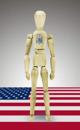bodypaint: Old wood figure mannequin with US state flag bodypaint - New Jersey Stock Photo
