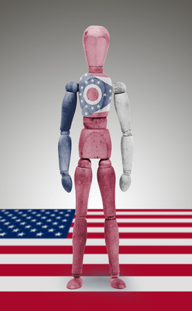 body paint: Old wood figure mannequin with US Ohio state flag body paint Stock Photo