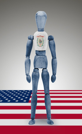 body paint: Old wood figure mannequin with US West Virginia state flag body paint