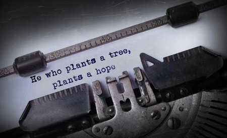 he old: Vintage inscription made by old typewriter, He who plants a tree, plants a hope