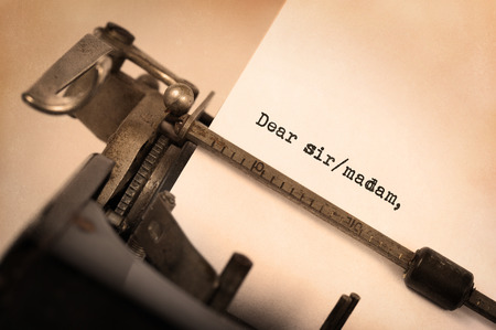 unsolicited: Close-up of a vintage typewriter with inscription, dear sirmadam Stock Photo