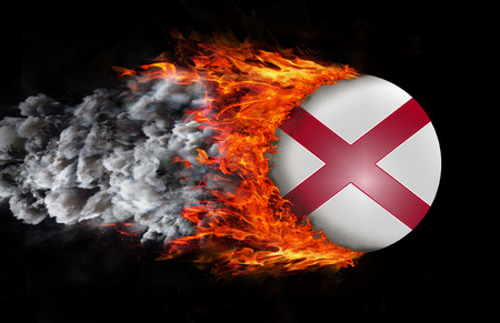 alabama flag: Concept of speed - Alabama Flag with a trail of fire and smoke