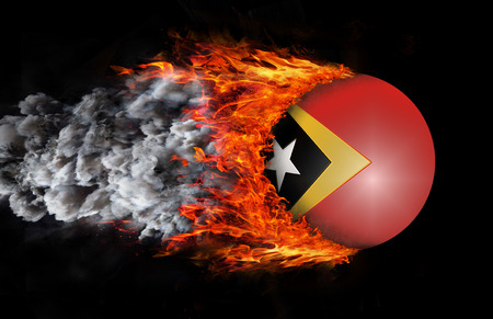 timor: Concept of speed - East Timor Flag with a trail of fire and smoke