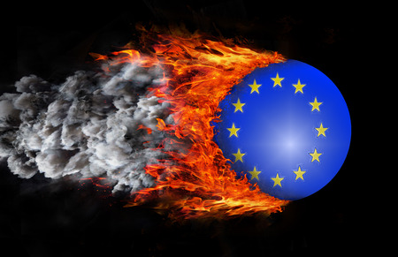 european union flag: Concept of speed - European Union Flag with a trail of fire and smoke